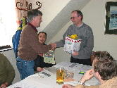 S57ULU (left) receiving prize for 1st place in S5 ATV contest 2002